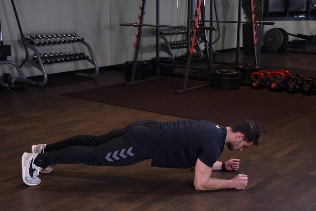 Plank - Izometryczny skurcz mięśni brzucha w podporze przodem