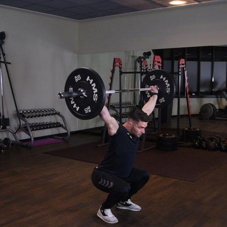 Ćwiczenie Przysiad ze sztangą nad głową - just be fit
